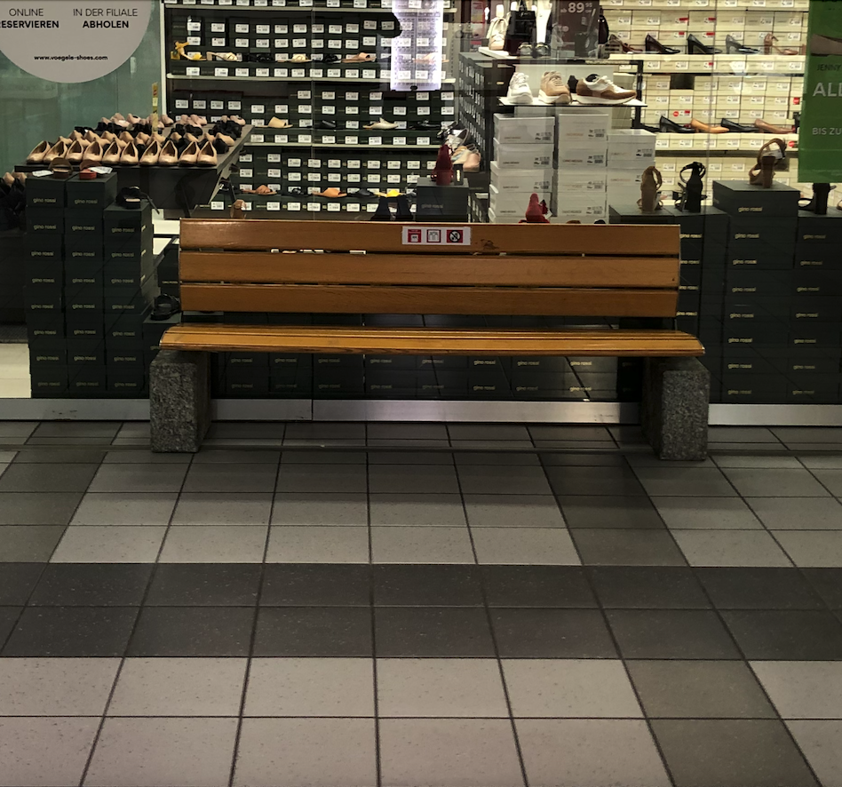 An empty bench at the shopping center